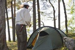 Senior man camping Stock Images