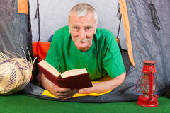 Senior man at the camping Stock Photography