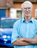 Senior man with car Royalty Free Stock Image