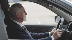 Senior man into the car. Businessman sitting in auto. stock footage