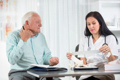 Senior man with a cardiologist Stock Photography