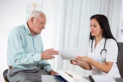 Senior man with a cardiologist Stock Photos