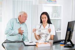 Senior man with a cardiologist Stock Photo