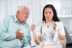 Senior man with a cardiologist Royalty Free Stock Photo