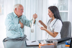 Senior man with a cardiologist Royalty Free Stock Image