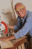 Senior Man Carpenter Working with Wood Royalty Free Stock Image