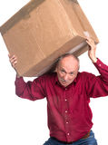 Senior man carries a heavy box. On a white background Royalty Free Stock Photo