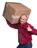 Senior man carries a heavy box. On a white background Stock Photo