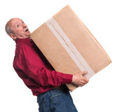Senior man carries a heavy box. On a white background Royalty Free Stock Images