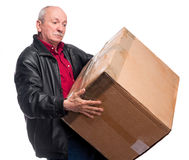 Senior man carries a heavy box. On a white background Stock Photography