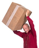 Senior man carries a heavy box. On a white background Stock Images