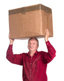 Senior man carries a heavy box. On a white background Royalty Free Stock Photos