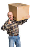 Senior man carries a heavy box Royalty Free Stock Images