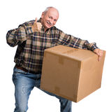 Senior man carries a heavy box. On a white background Royalty Free Stock Photography