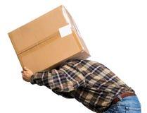 Senior man carries a heavy box Stock Photo