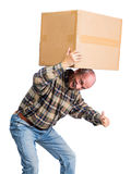 Senior man carries a heavy box. On a white background Royalty Free Stock Image