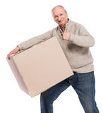 Senior man carries a heavy box. On a white background Stock Image