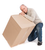 Senior man carries a heavy box. Senior man with heavy box on a white background Royalty Free Stock Photography