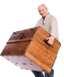 Senior man carries a heavy box Stock Photography