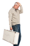 Senior man carries white suitcase Royalty Free Stock Photos