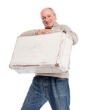 Senior man carries white suitcase Stock Photography