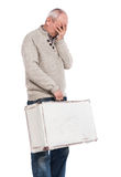 Senior man carries white suitcase Royalty Free Stock Image