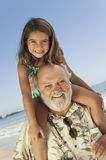 Senior Man Carrying Granddaughter On Shoulder Stock Photos