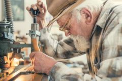 Senior man carving Stock Images