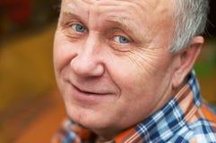 Senior man casual portrait. Casual bald senior man emotional portrait series Royalty Free Stock Image