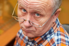Senior man casual portrait. Casual senior man with glasses. Emotional portrait series Royalty Free Stock Images