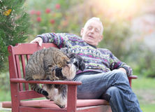 Senior man with cat and dog Stock Photography