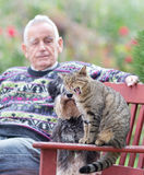 Senior man with cat and dog Stock Image