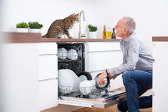 Senior man with cat in kitchen 2 Royalty Free Stock Image