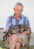 Senior man with cat Stock Images