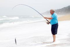 Senior man catching fish Royalty Free Stock Images
