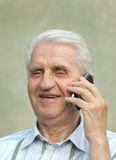 Senior man with cell phone Royalty Free Stock Photo