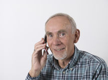 Senior man on cellphone. Old man enjoying a phone call on his cellphone Stock Photography