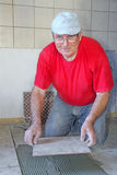 Senior man with ceramics Royalty Free Stock Photos
