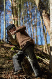 Senior man with chainsaw in a forest Royalty Free Stock Photos