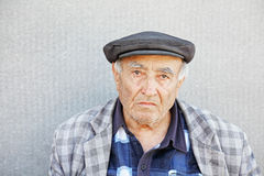 Senior man in checkered jacket and cap Stock Photo
