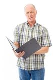 Senior man checking a file Stock Photo