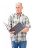 Senior man checking a file Royalty Free Stock Photos