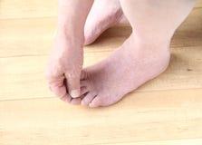 Senior man checking his toes Stock Photography