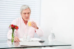 Senior man checking stock quotes Stock Images