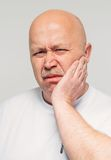 Senior man with cheek soreness or tooth pain Stock Photos