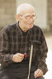 Senior man with cherry Stock Photo