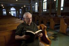 Senior man in church stock photo