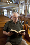 Senior man in church Stock Images
