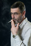 Senior man with cigarette Stock Image