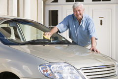Senior man cleaning car Royalty Free Stock Images